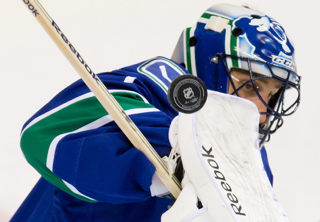 . Vancouver Canucks\' goalie Roberto Luongo makes a blocker save against the Colorado Avalanche during second period NHL hockey game in Vancouver, British Columbia on Sunday, Dec. 8, 2013. (AP Photo/The Canadian Press, Darryl Dyck)