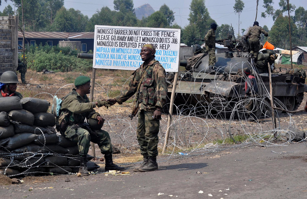 . Congolese government army soldiers are seen at a checkpoint in Kanyarustshinya, outside the eastern Congolese city of Goma July 16, 2013. Congolese government forces supported by helicopters attacked M23 rebel positions near the eastern city of Goma on Tuesday in a third day of heavy fighting that has forced hundreds of villagers to flee their homes and raised tensions with Rwanda. REUTERS/Chrispin Mvano