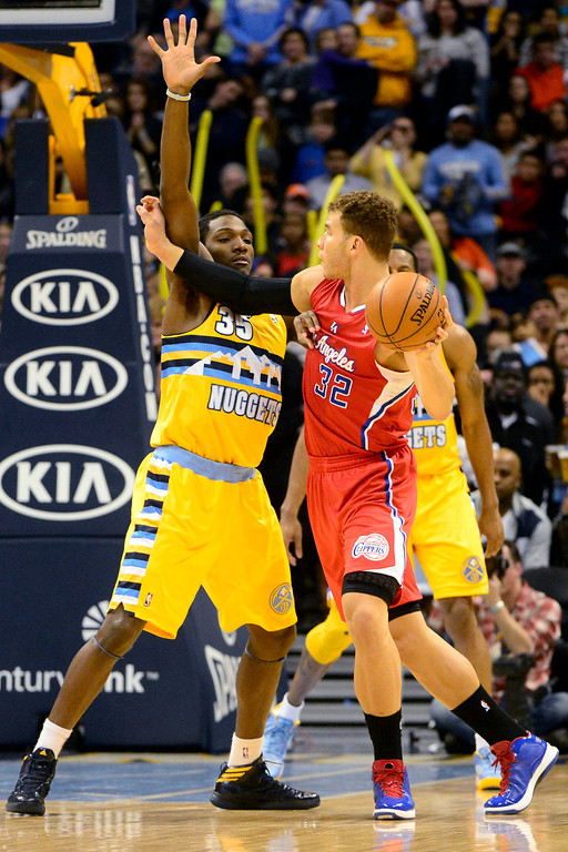 . Denver Nuggets small forward Kenneth Faried (35) guards Los Angeles Clippers power forward Blake Griffin (32) during the first half at the Pepsi Center on Tuesday, January 1, 2013. AAron Ontiveroz, The Denver Post