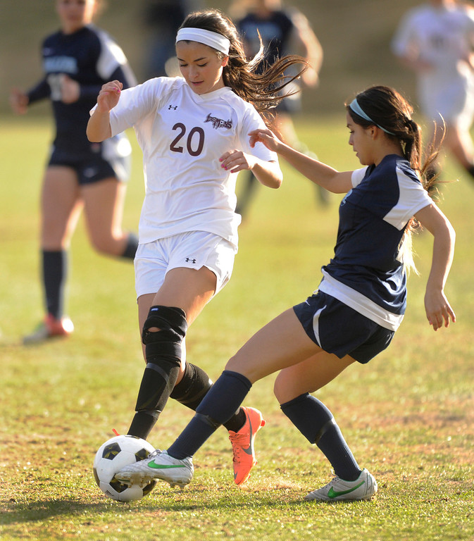 . PARKER, CO. - APRIL 2: Valor midfielder Amanda Lopez, right, challenged Demons forward Sarah Tasci, left, for the ball in the first half. The Valor Christian High School girl\'s soccer team defeated Golden 4-1 Wednesday night, April 3, 2013.  Photo By Karl Gehring/The Denver Post)