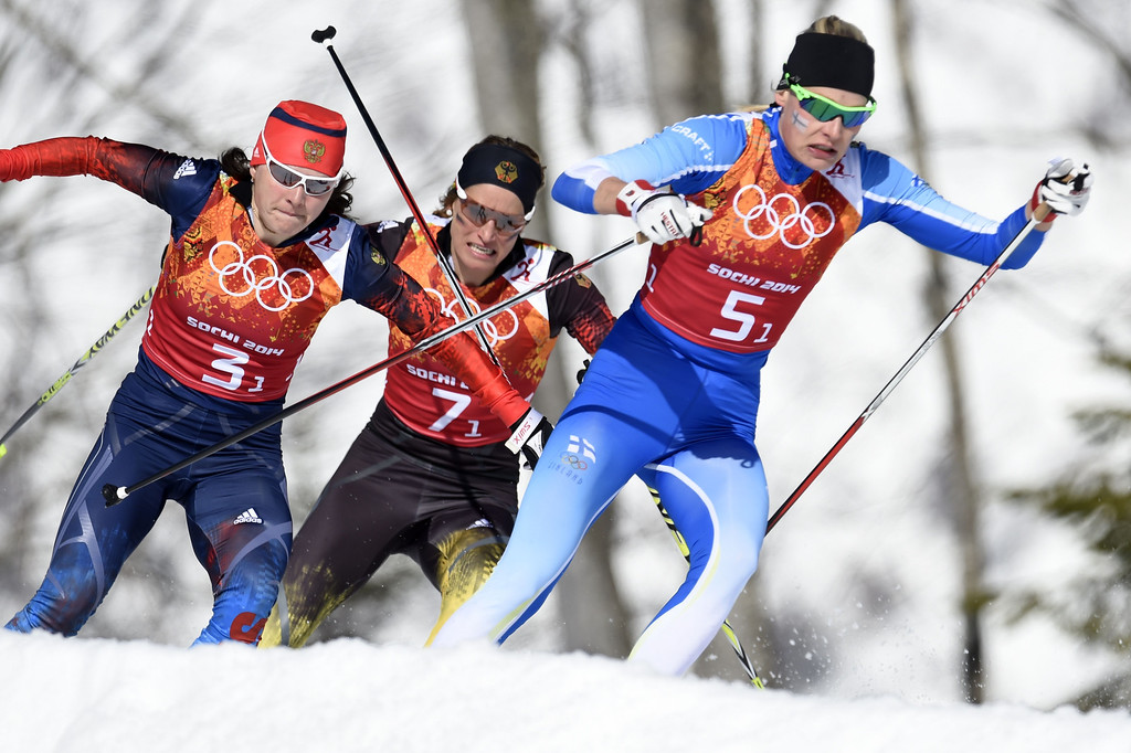 . (L-R) Russia\'s Julia Ivanova, Germany\'s Nicole Fessel, Finland\'s Anne Kylloenen compete in the Women\'s Cross-Country Skiing 4x5km Relay at the Laura Cross-Country Ski and Biathlon Center during the Sochi Winter Olympics on February 15, 2014, in Rosa Khutor, near Sochi.    ODD ANDERSEN/AFP/Getty Images