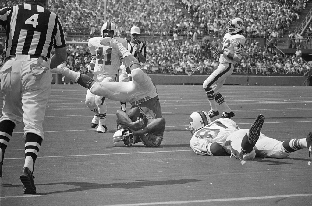 . Larry Csonka (39) of the Miami Dolphins gets some neck strain as he makes 4-yards and a first down In Miami, Fla., Oct. 22, 1972 against the Buffalo Bills. (AP Photo)