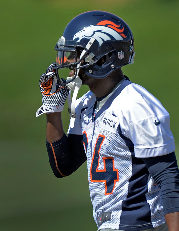 . Denver Broncos cornerback Champ Bailey (24) gets his helmet on as he prepares for practice  September 3, 2013 at Dove Valley. (Photo by John Leyba/The Denver Post)