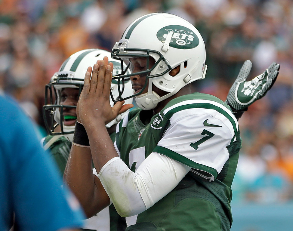 . New York Jets quarterback Geno Smith (7) celebrates after his 7-yard touchdown run against the Miami Dolphins during the second quarter of an NFL football game Sunday, Dec. 29, 2013, in Miami Gardens, Fla. (AP Photo/Lynne Sladky)