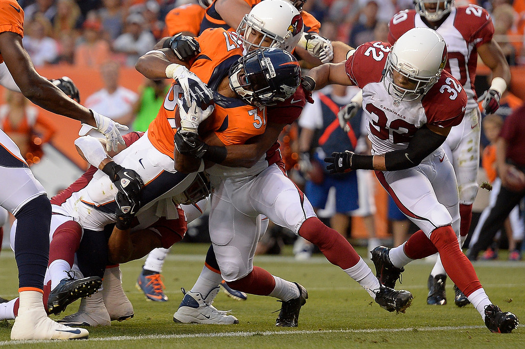 . Denver Broncos running back Jeremiah Johnson (37) scores against the Arizona Cardinals during the first half on August 29, 2013 at Sports Authority Field at Mile High. The Denver Broncos hosted the Arizona Cardinals in the final game of the preseason. (Photo by John Leyba/The Denver Post)