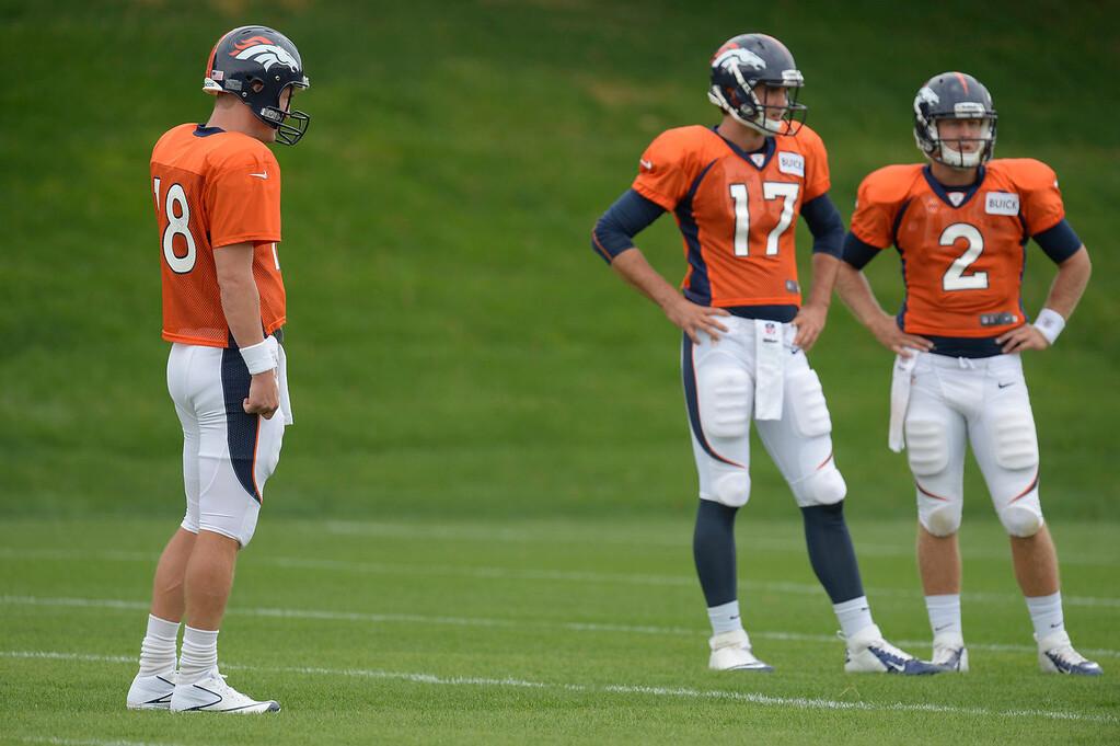 . Denver Broncos quarterback Peyton Manning (18) Denver Broncos quarterback Brock Osweiler (17) and Denver Broncos quarterback Zac Dysert (2) look on during practice September 1, 2013 at Dove Valley. (Photo by John Leyba/The Denver Post)