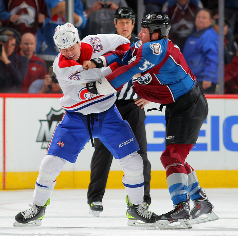. DENVER, CO - NOVEMBER 02:  Ryan White #53 of the Montreal Canadiens and Cody McLeod #55 of the Colorado Avalanche engage in a fight in the first period at Pepsi Center on November 2, 2013 in Denver, Colorado.  (Photo by Doug Pensinger/Getty Images)