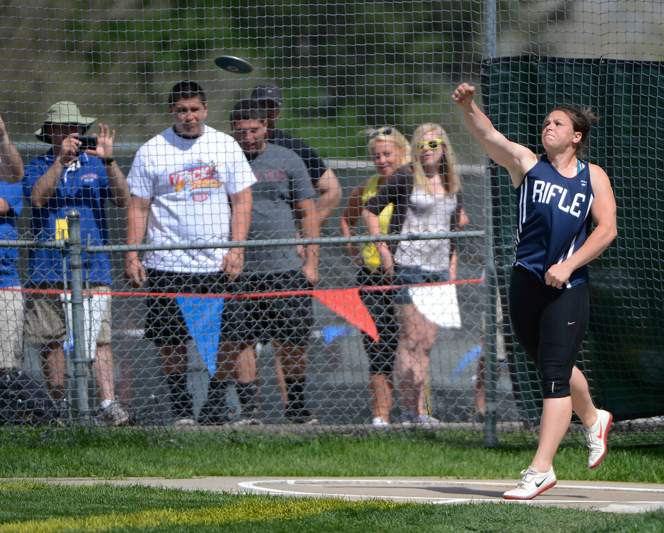 """. LAKEWOOD, CO - MAY 18: Joey Kuheim, Rifle High School, competes during the girls 4A discus throw at the Colorado State Track and Field Championships at Jeffco Stadium, Saturday morning, May 18, 2013. Kuheim finished third with her longest throw being 135\' 6\"""" (Photo By Andy Cross/The Denver Post)"""