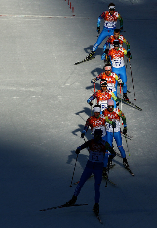 . Forerunners make their way along a section of the course before the Nordic Combined Individual Gundersen Normal Hill and 10km Cross Country on day 5 of the Sochi 2014 Winter Olympics at the RusSki Gorki Nordic Combined Skiing Stadium on February 12, 2014 in Sochi, Russia.  (Photo by Al Bello/Getty Images)