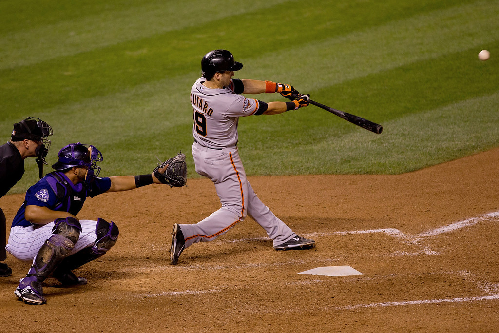 . DENVER, CO - AUGUST 27:  Marco Scutaro #19 of the San Francisco Giants hits an RBI sacrifice fly during the seventh inning against the Colorado Rockies at Coors Field on August 27, 2013 in Denver, Colorado.  The Giants defeated the Rockies 5-3.  (Photo by Justin Edmonds/Getty Images)