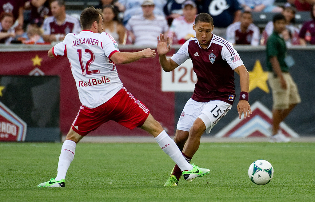 . DENVER - JULY 4: Christopher Klute, #15 of the Colorado Rapids, drives the ball around Eric Alexander, #12 of the New York Red Bulls, during the first half of a MLS soccer match against the New York Red Bulls on July 4, 2013 at Dick\'s Sporting Goods Park. (Photo By Grant Hindsley / The Denver Post)