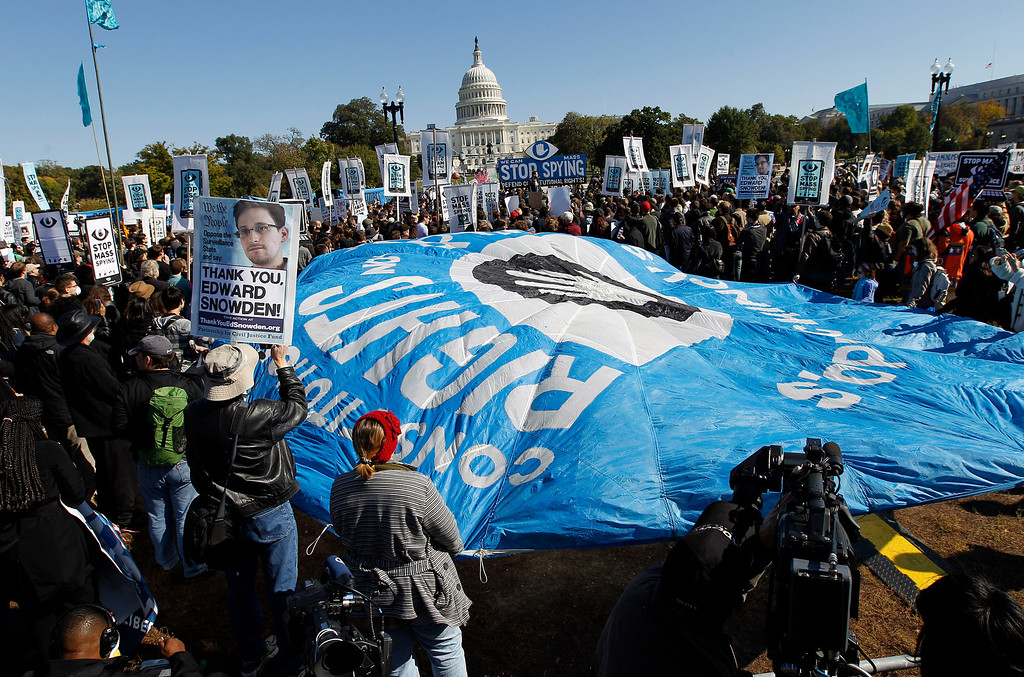. Demonstrators rally near the U.S. Capitol in Washington to demand that Congress investigate the National Security Agency\'s mass surveillance programs Saturday, Oct. 26, 2013. ( AP Photo/Jose Luis Magana)