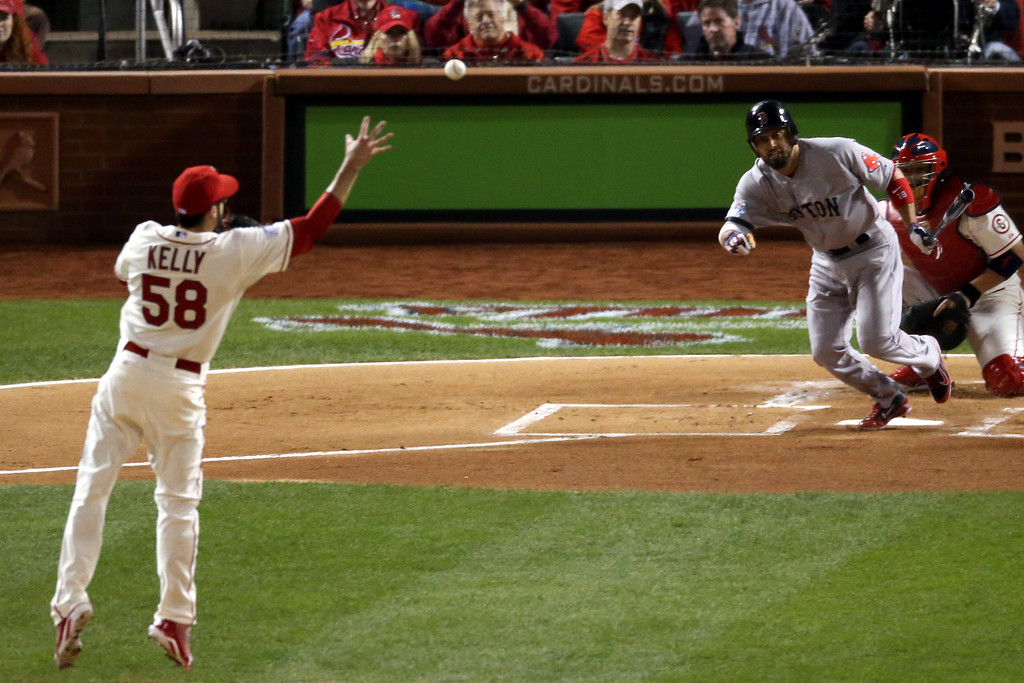 . ST LOUIS, MO - OCTOBER 26:  Shane Victorino #18 of the Boston Red Sox grounds out to Joe Kelly #58 of the St. Louis Cardinals in the first inning of Game Three of the 2013 World Series at Busch Stadium on October 26, 2013 in St Louis, Missouri.  (Photo by Rob Carr/Getty Images)