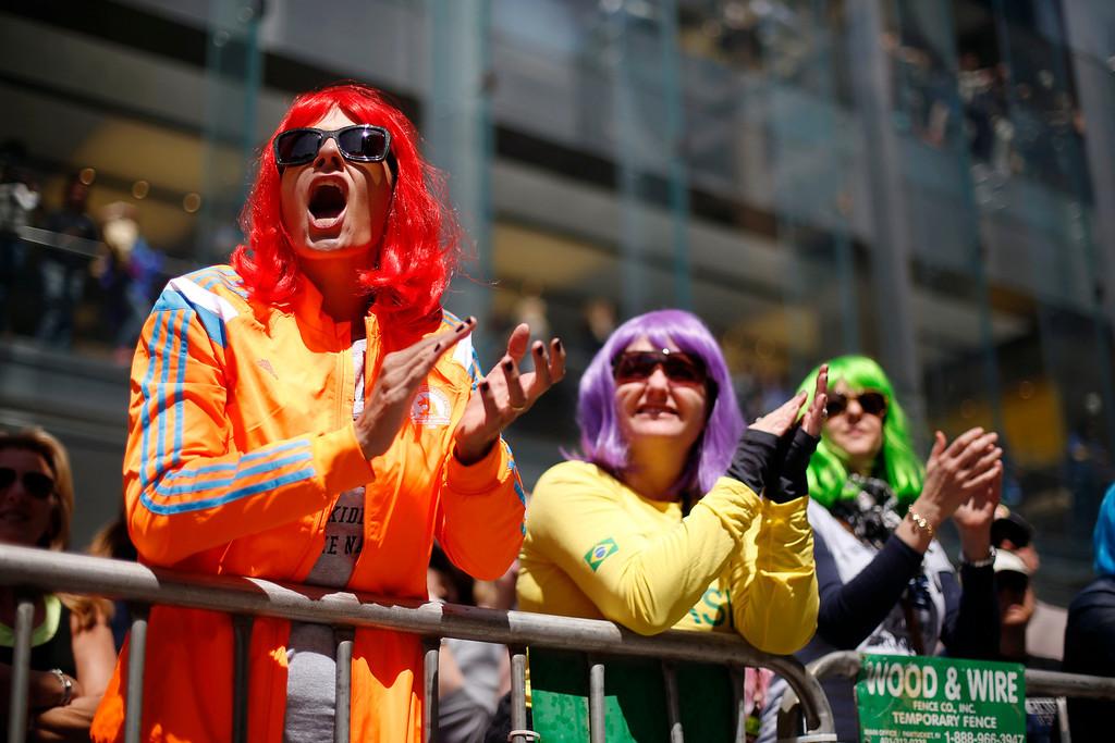. Race fans cheer runners at mile marker 26 of the 118th Boston Marathon Monday, April 21, 2014 in Boston. (AP Photo/Robert F. Bukaty)