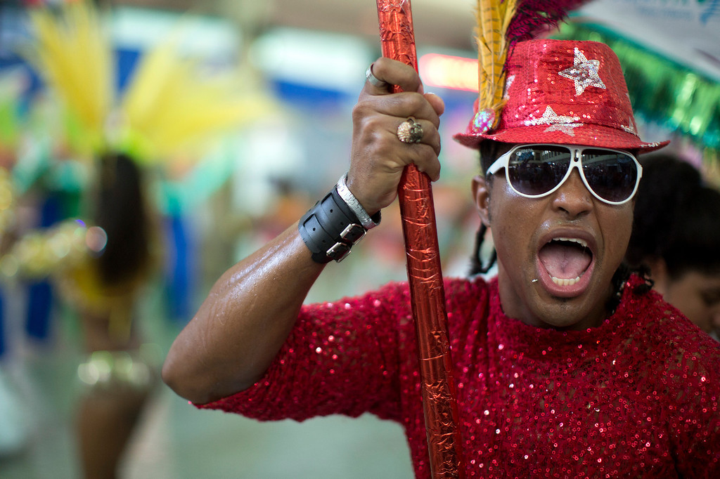 . A man dances at the \'Carnaval na Central\' carnival block parade, in central station, during pre-carnival celebrations in Rio de Janeiro, Brazil, Saturday, Feb. 2, 2013. (AP Photo/Felipe Dana)