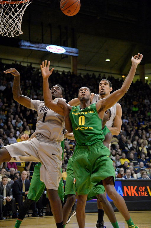 . Colorado Buffaloes forward Wesley Gordon (1) battles for a rebound with Oregon Ducks forward Mike Moser (0) during the second half January 5, 2014 at Coors Events Center. Colorado Buffaloes defeated th eOregon Ducks 100-91. (Photo by John Leyba/The Denver Post)