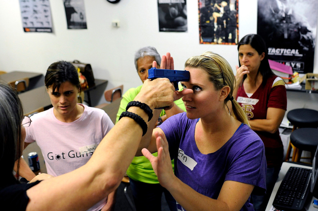 . A group of local public school teachers from nearby schools use rubber training guns as they practice drills on disarming an attacker during a teachers-only firearms training class offered for free at the Veritas Training Academy in Sarasota, Florida January 11, 2013.  REUTERS/Brian Blanco