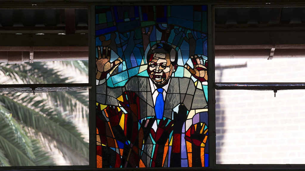 . A stained-glass tribute to Nelson Mandela in Regina Mundi Catholic Church in Soweto Township as the funeral of the former South African President takes place in Qunu on December 15, 2013 in Soweto, South Africa. Mr Mandela passed away on the evening of December 5, 2013 at his home in Houghton at the age of 95. Mandela became South Africa\'s first black president in 1994 after spending 27 years in jail for his activism against apartheid in a racially-divided South Africa.  (Photo by Oli Scarff/Getty Images)