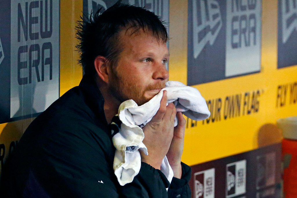 . Colorado Rockies starting pitcher Brett Anderson wipes his face in the dugout during the fourth inning of a baseball game against the Colorado Rockies in Pittsburgh Saturday, July 19, 2014. (AP Photo/Gene J. Puskar)