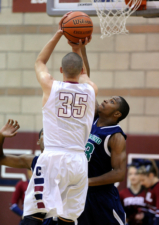. Overland forward Tre Thomas (23) went for the block on Cherokee Trail senior Drick Bernstine (35) in the second half. The Cherokee Trail boy\'s basketball team defeated Overland 59-57 Friday night, January 11, 2013. Karl Gehring/The Denver Post
