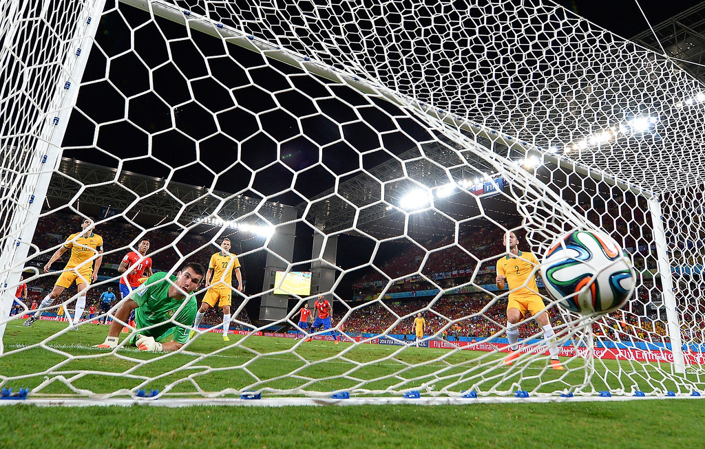 . Chile\'s forward Alexis Sanchez (not in picture) scores past Australia\'s goalkeeper Mathew Ryan (C) during a Group B football match between Chile and Australia at the Pantanal Arena in Cuiaba during the 2014 FIFA World Cup on June 13, 2014. WILLIAM WEST/AFP/Getty Images