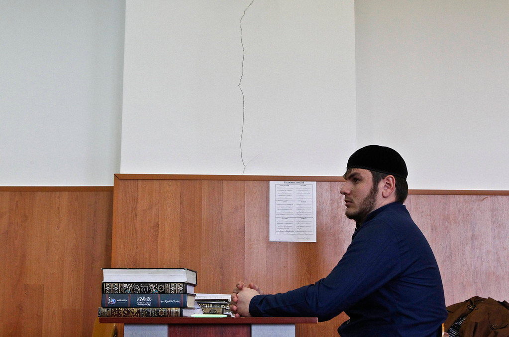 . A student attends a lesson at the Russian Islamic University in the Chechen capital Grozny April 23, 2013. The naming of two Chechens, Dzhokhar and Tamerlan Tsarnaev, as suspects in the Boston Marathon bombings has put Chechnya - the former site of a bloody separatist insurgency - back on the world\'s front pages. Chechnya appears almost miraculously reborn. The streets have been rebuilt. Walls riddled with bullet holes are long gone. New high rise buildings soar into the sky. Spotless playgrounds are packed with children. A giant marble mosque glimmers in the night. Yet, scratch the surface and the miracle is less impressive than it seems. Behind closed doors, people speak of a warped and oppressive place, run by a Kremlin-imposed leader through fear.  Picture taken April 23, 2013.   REUTERS/Maxim Shemetov