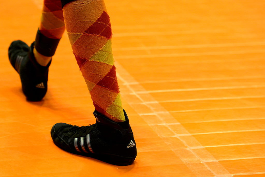 . DENVER, CO - FEBRUARY 21: Gateway 145-pounder Deyaun Trueblood rocks a pair of orange argyle socks en route to beating Ponderosa\'s Torry Williams 7-5 during the Colorado State High School Wrestling Championships. The state finals will run through Saturday evening at the Pepsi Center. (Photo by AAron Ontiveroz/The Denver Post)