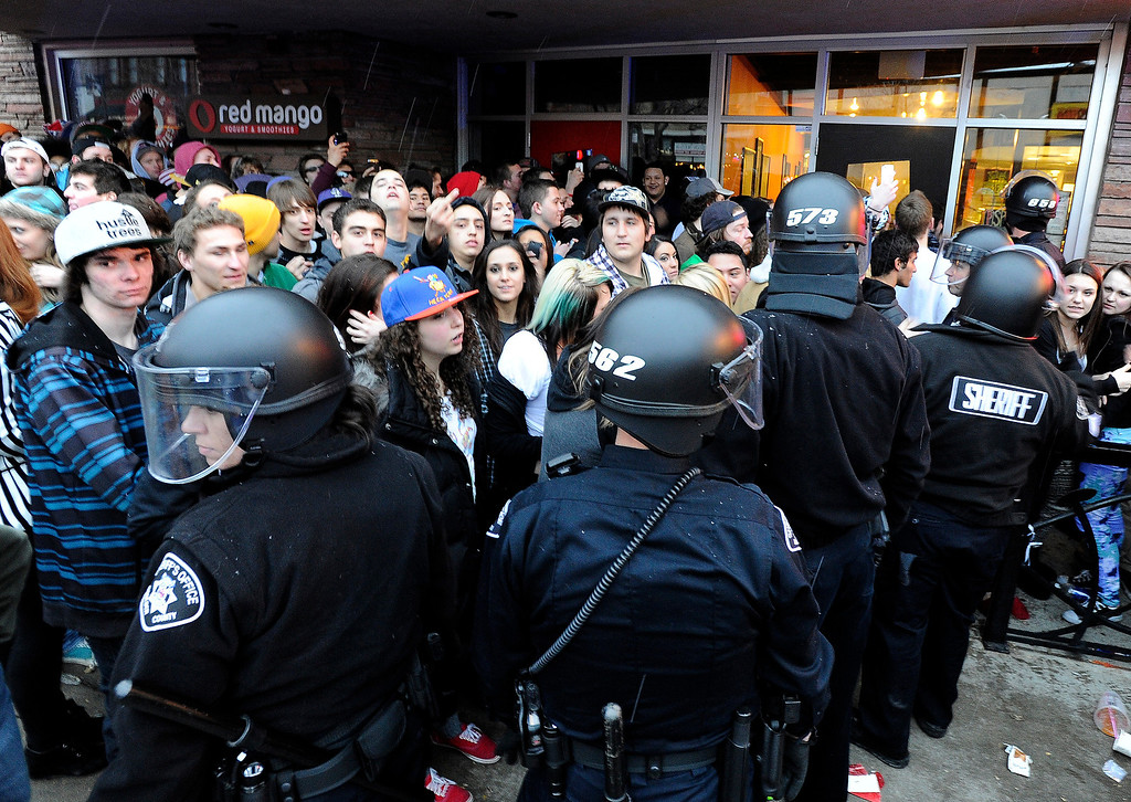 . Boulder Police officers dressed in riot gear try to keep the crowd under control during a disturbance at the Fox Theater on Monday, March 11, in Boulder. Boulder Police responded with riot gear to keep the fans of the band Tyler the Creator under control.  Jeremy Papasso/Boulder Daily Camera