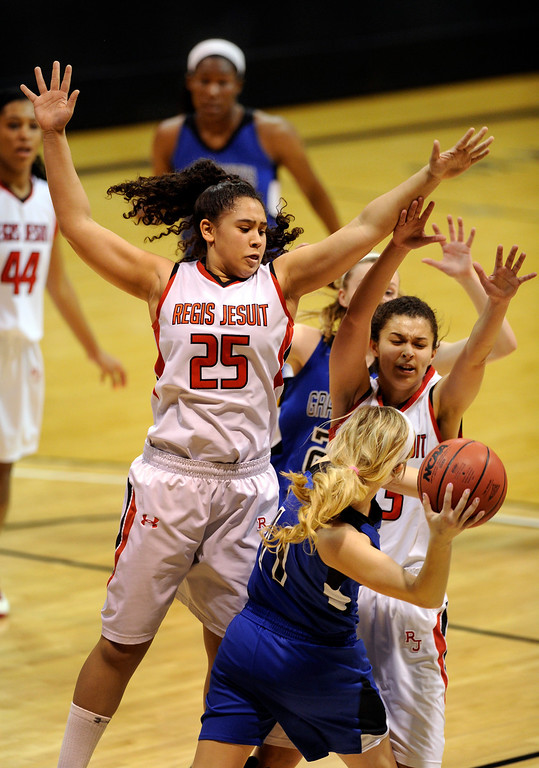 . BOULDER, CO. - MARCH 14: Grandview senior guard Brooke Genovese (11) tried to get the ball past Regis defenders Kelsi Lidge (25) and Jessica Lewis (33) in the first half. The Regis Jesuit High School girl\'s basketball team edged Grandview 46-43 Thursday night, March 14, 2013 at the Coors Events Center in Boulder.  (Photo By Karl Gehring/The Denver Post)