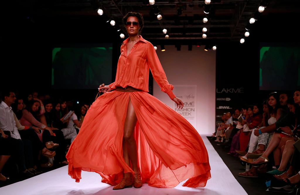 . A model displays a creation by designer Suman Nathwani during the Lakme Fashion Week in Mumbai, India, Thursday, March 13, 2014. (AP Photo/Rafiq Maqbool)