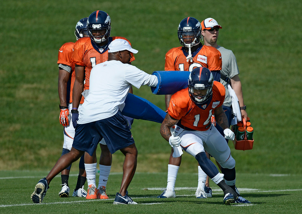 . Denver Broncos wide receiver Cody Latimer (14) runs through drills on day five of the Denver Broncos 2014 training camp July 28, 2014 at Dove Valley. (Photo by John Leyba/The Denver Post)