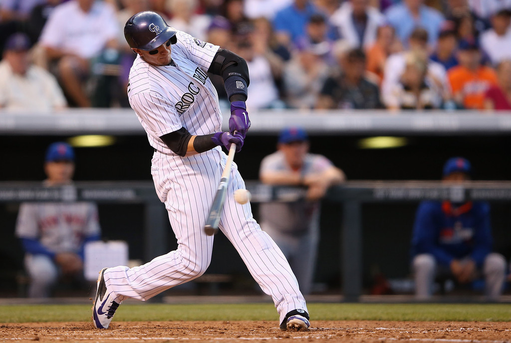 . DENVER, CO - MAY 03:  Shortstop Troy Tulowitzki #2 of the Colorado Rockies hits a single off of starting pitcher Jenrry Mejia #58 of the New York Mets in the fourth inning at Coors Field on May 3, 2014 in Denver, Colorado.  (Photo by Doug Pensinger/Getty Images)