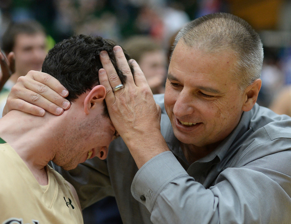 . FORT COLLINS, CO. - JANUARY 18:  Rams coach Larry Eustachy grabbed freshman guard David Cohn at the end of the game to celebrate the win. The Colorado State men\'s basketball team defeated Air Force 74-68 at Moby Arena in Fort Collins Saturday night, January 18, 2014. Photo By Karl Gehring/The Denver Post