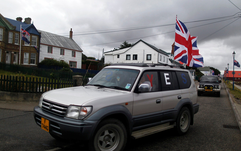 """. A vehicle with the word \""""Yes\"""" stamped on its windows drives by on Ross road during a parade in Stanley, March 10, 2013. Voters in the remote British-ruled Falkland Islands hold a referendum on their future today that seeks to challenge Argentina\'s increasingly vocal sovereignty claim. REUTERS/Marcos Brindicci"""