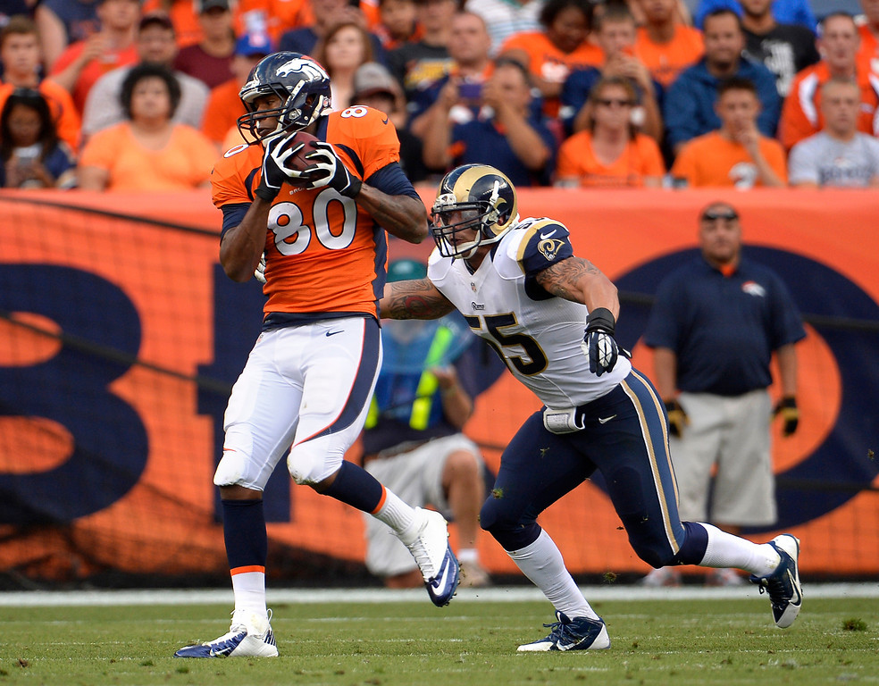 . 10. Which unheralded player has the best chance to make a mark this season?  The answer to this question last year would have been defensive backs Chris Harris and Tony Carter. Only no one knew who they were until the second half of Game 6 at San Diego, when the Broncos rallied from a 24-0 deficit for a 35-24 victory. Regardless of the hype of the Big Three receivers, tight end Julius Thomas has a chance to become a second- or third-favorite target by season�s end. Weakside linebacker Danny Trevathan, who played only in the nickel last year as a rookie, has a chance to follow Wesley Woodyard�s career path. And wouldn�t it be something if Rahim Moore had a Pro Bowl season?  Above: The tight end Julius Thomas (80) of the Denver Broncos pulls in a pass in the first half vs the St. Louis Rams during the 3rd pre-season game of the season at Sports Authority Field at Mile High. August 24, 2013 Denver, Colorado. (Photo By Joe Amon/The Denver Post)