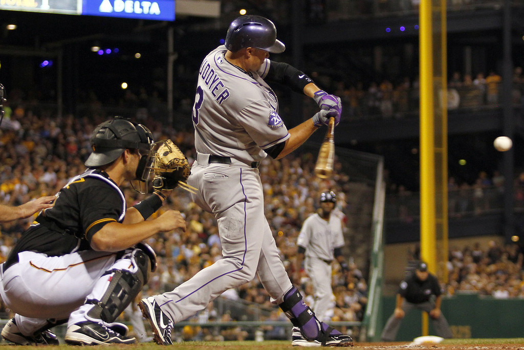 . PITTSBURGH, PA - AUGUST 03:  Michael Cuddyer #3 of the Colorado Rockies reached on infield single scoring a run in the eighth inning against the Pittsburgh Pirates during the game on August 3, 2013 at PNC Park in Pittsburgh, Pennsylvania.  (Photo by Justin K. Aller/Getty Images)
