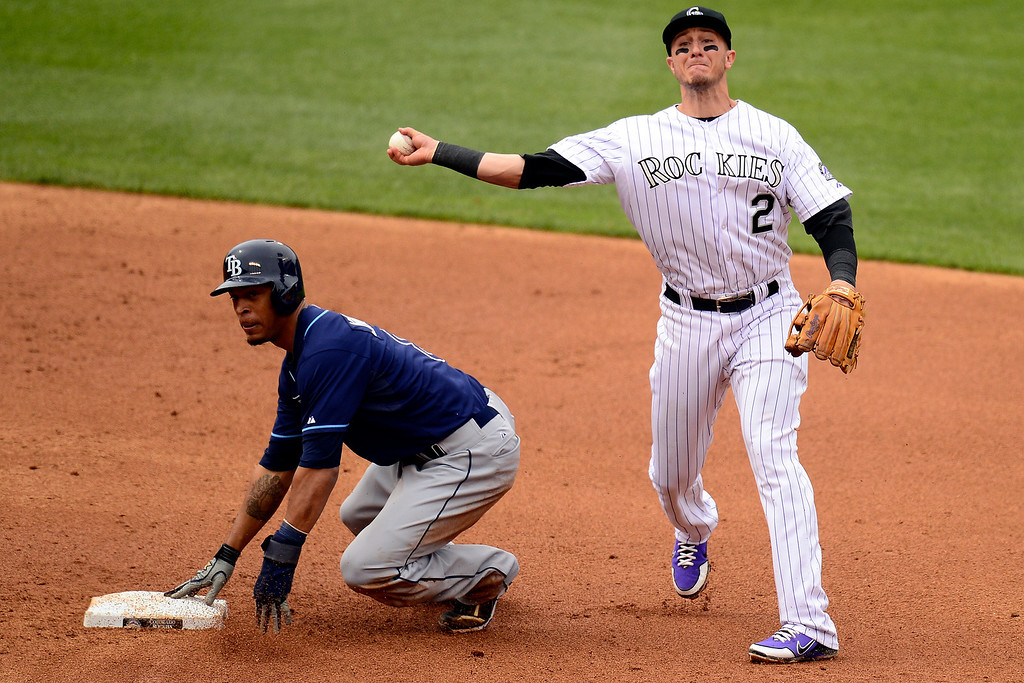 . DENVER, CO - MAY 5: Troy Tulowitzki (2) of the Colorado Rockies turns a double play on Evan Longoria (3) as Desmond Jennings (8) of the Tampa Bay Rays watches after being forced out during the Rockies\' 8-3 loss.. The Tampa Bay Rays took two of three games from the Rockies in the series. (Photo by AAron Ontiveroz/The Denver Post)