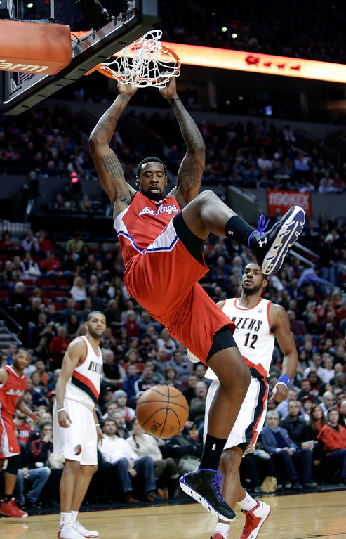 . Los Angeles Clippers center DeAndre Jordan, middle, scores against the Portland Trail Blazers\' LaMarcus Aldridge, right, and Nicolas Batum, left, during the first quarter of an NBA basketball game in Portland, Ore., Saturday, Jan. 26, 2013.(AP Photo/Don Ryan)