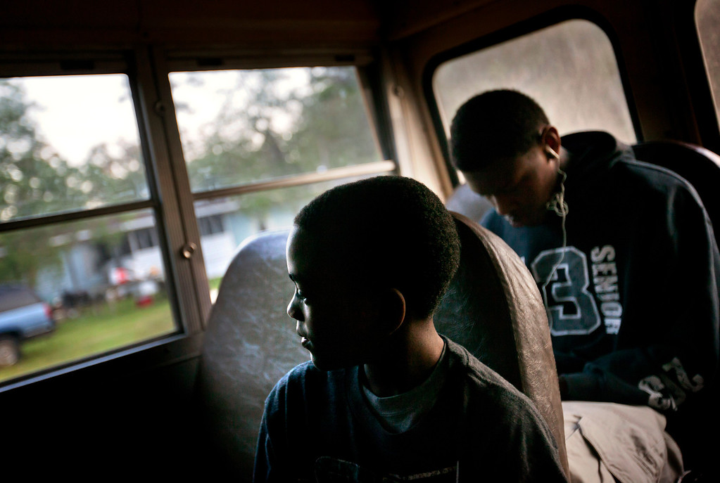 . J.J. Wilson 9, rides a school bus to catch a ferry to the his school on the mainland from his home in the Hog Hammock community of Sapelo Island, Ga. on Wednesday, May 15, 2013. Eight children catch a ferry in the morning to attend school on the mainland since the last school operating on the island closed in 1978. (AP Photo/David Goldman)