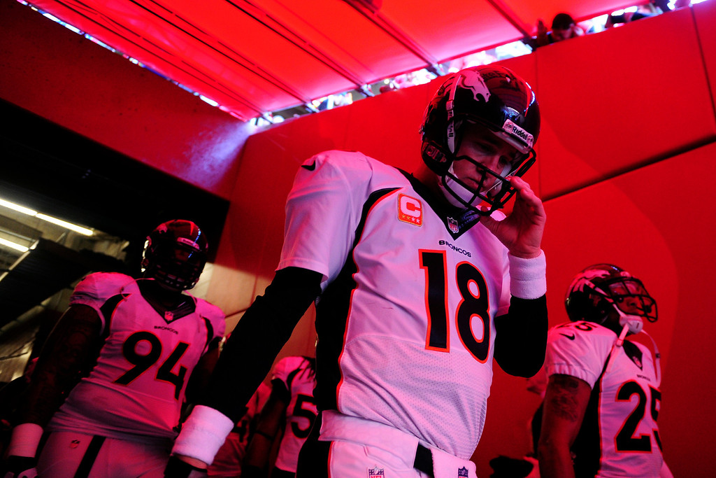 . Peyton Manning (18) of the Denver Broncos waits to take the field against the Kansas City Chiefs before the first half of action at Arrowhead Stadium.   (Photo by AAron Ontiveroz/The Denver Post)