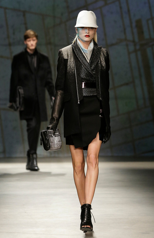 . Models walk the runway during the presentation of the Kenneth Cole Fall 2013 fashion collection during Fashion Week in New York, Thursday, Feb. 7, 2013.  (AP Photo/Kathy Willens)