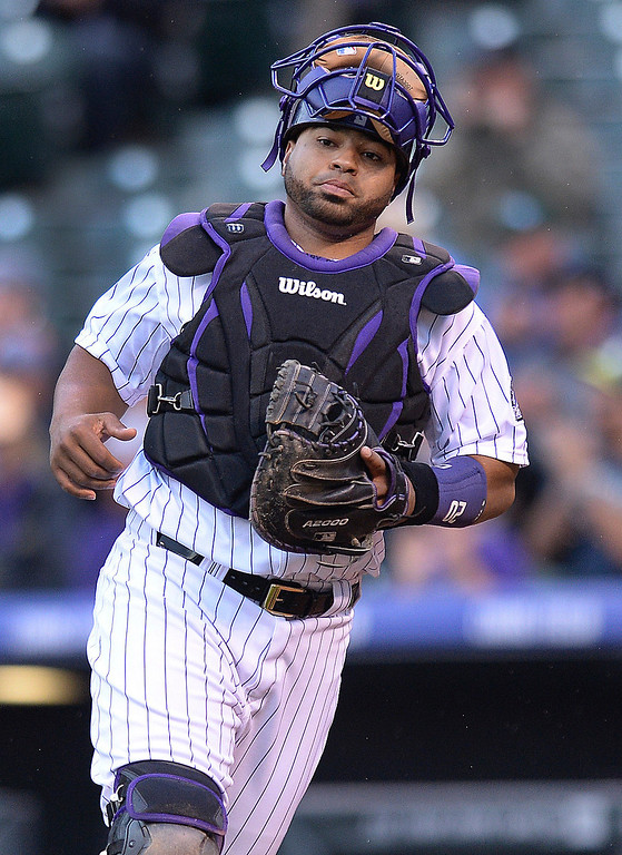 . Colorado catcher Wilin Rosario took the field Wednesday night. The Colorado Rockies hosted the San Francisco Giants Wednesday night, May 21, 2014.  (Photo by Karl Gehring/The Denver Post)
