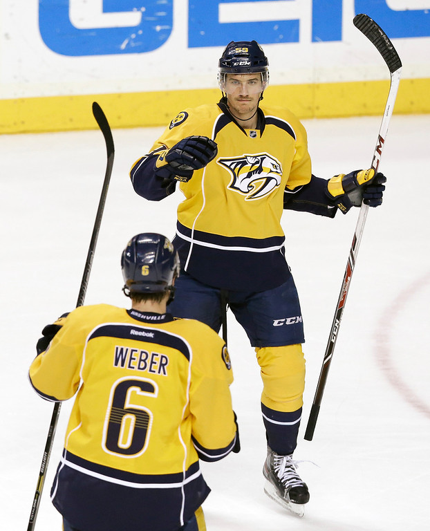 . Nashville Predators defenseman Roman Josi, right, of Switzerland, celebrates with Shea Weber (6) after Josi scored against the Colorado Avalanche in the third period of an NHL hockey game, Saturday, Jan. 18, 2014, in Nashville, Tenn. The Avalanche won 5-4. (AP Photo/Mark Humphrey)