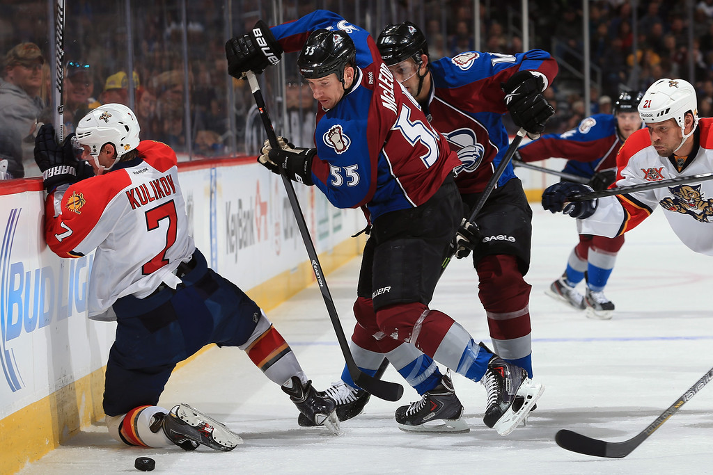 . DENVER, CO - NOVEMBER 16:  Cody McLeod #55 of the Colorado Avalanche takes control of the puck against Dmitry Kulikov #7 of the Florida Panthers at Pepsi Center on November 16, 2013 in Denver, Colorado.  (Photo by Doug Pensinger/Getty Images)