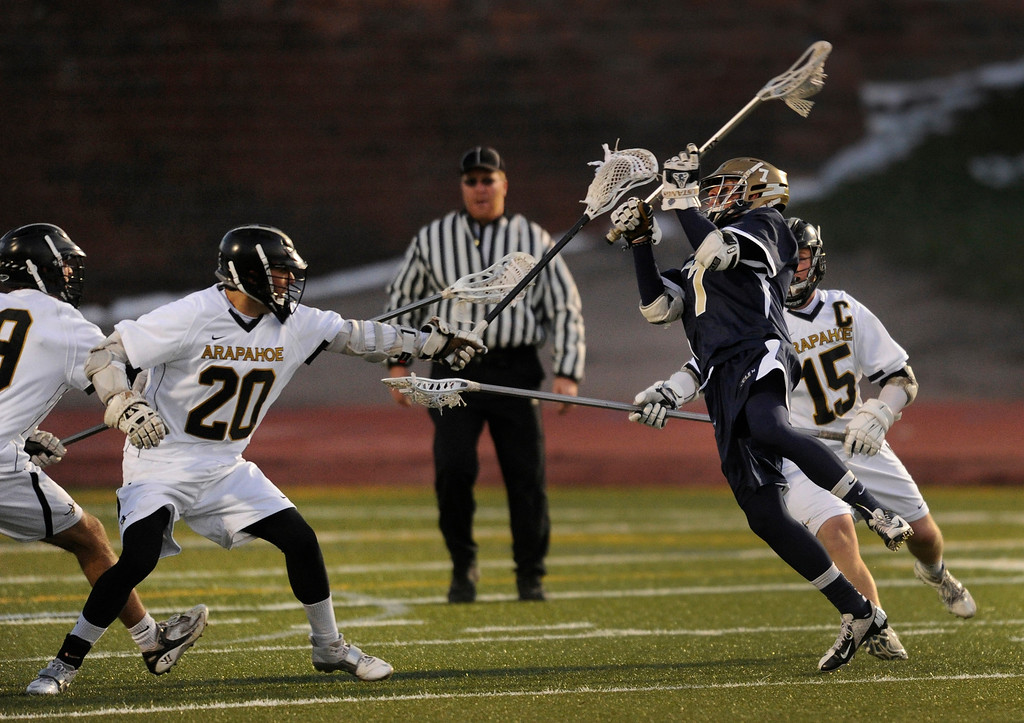 . LITTLETON, CO. - APRIL 10: Mustangs\' junior middie Nick Philips (7) tied the game 3-3 in the first half. The Mullen High School boy\'s lacrosse team defeated Arapahoe 8-7 Wednesday night, April 10, 2013. Photo By Karl Gehring/The Denver Post)