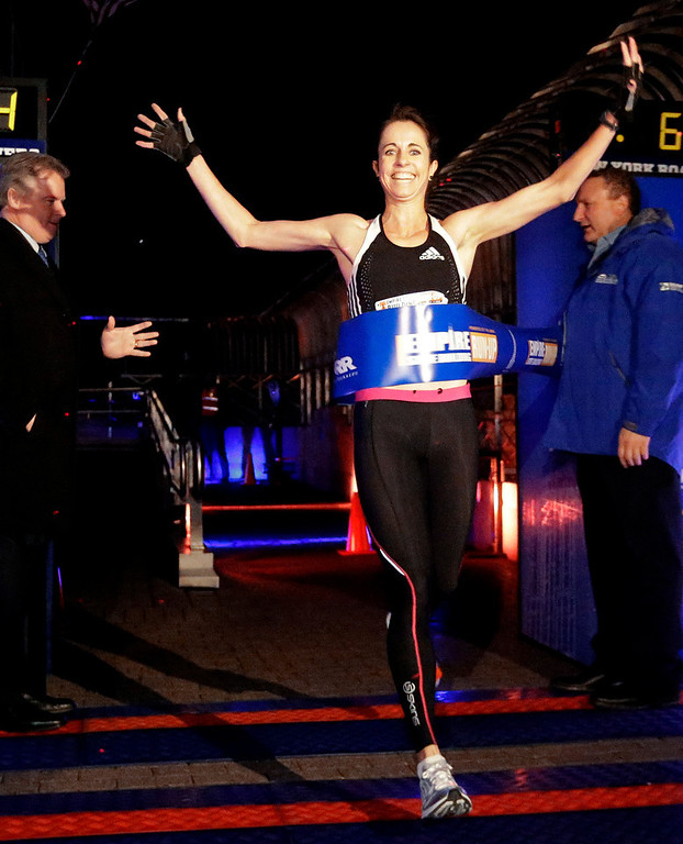 . Suzy Walsham, of Australia, wins the women\'s invitational of the Empire State Building Run-Up, Wednesday, Feb. 6, 2013, in New York. (AP Photo/Frank Franklin II)