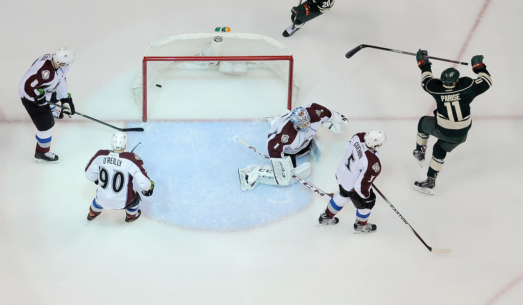 . Minnesota Wild left wing Zach Parise (11) celebrates his goal on Colorado Avalanche goalie Semyon Varlamov (1) as Colorado Avalanche defenseman Jan Hejda (8) Colorado Avalanche center Ryan O\'Reilly (90) and Colorado Avalanche defenseman Nate Guenin (5) look on during the first period  April 28, 2014 in Game 6 of the Stanley Cup Playoffs at Xcel Energy Center.  (Photo by John Leyba/The Denver Post)