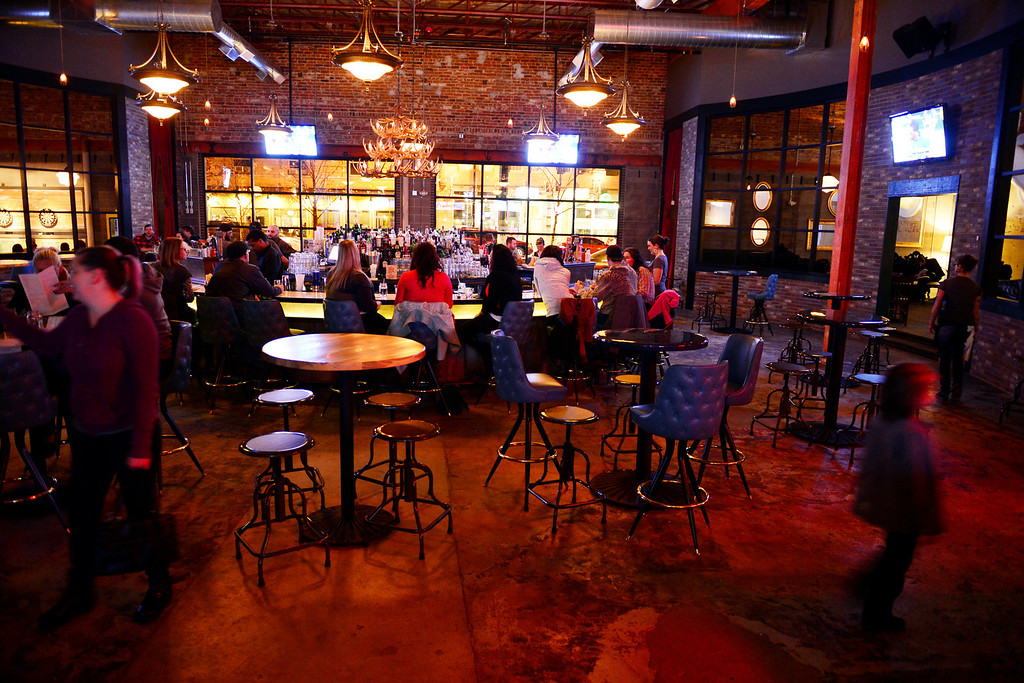 . Patrons mingle at the Punch Bowl on Sunday, November 25, 2012. AAron Ontiveroz, The Denver Post