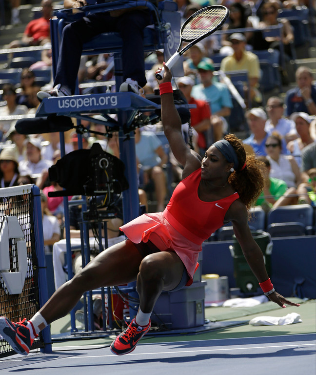 . Serena Williams falls after an off-balance shot against Galina Voskoboeva of Kazakhstan during the second round of the 2013 U.S. Open tennis tournament, Thursday, Aug. 29, 2013, in New York. (AP Photo/Kathy Willens)