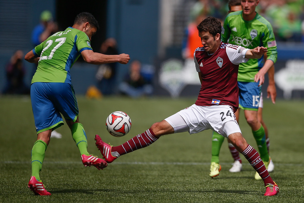 . Nathan Sturgis #24 of the Colorado Rapids battles Lamar Neagle #27 of the Seattle Sounders FC at CenturyLink Field on April 26, 2014 in Seattle, Washington. (Photo by Otto Greule Jr/Getty Images)